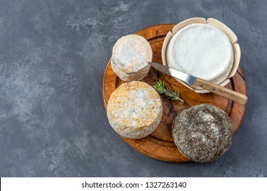 Corsican traditional varity of goat and sheep cheese on a grey slate background