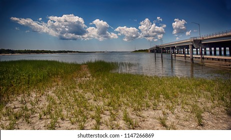 Corson Inlet is a narrow strait on the southern coast of New Jersey in the United States. It leads from the Atlantic Ocean through barrier islands off the northeast coast of Cape May County, New Jerse