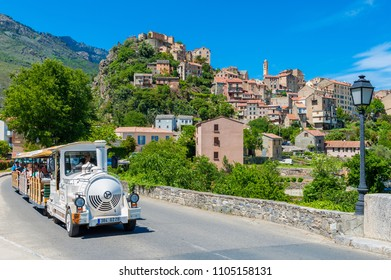 Corte, Corsica, France - May 17, 2011: Tourist Train driving through Street in Corte, Corsica, France. Corte is best known for its Citadel and University.