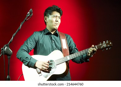 """CORTEFRANCA,ITALY - AUGUST 28:  exhibition live of the  chinese guitar player Joe Zhu at the event """"Acoustic Franciacorta 2014"""",28 August ,2014 in Cortefranca,Italy"""