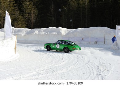 CORTINA D'AMPEZZO, ITALY - FEBRUARY 21: A green and black Porsche 911 ST takes part to the WinteRace classic car race on February 21, 2014 in Cortina d'Ampezzo . This car was built in 1972.
