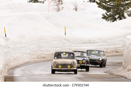 CORTINA D'AMPEZZO, ITALY - FEBRUARY 21: Three classic British cars take part to the WinteRace classic car race on February 21, 2014 in Cortina d'Ampezzo.