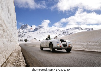 CORTINA D'AMPEZZO, ITALY - FEBRUARY 21: A silver Lancia Aprilia Barchetta takes part to the WinteRace classic car race on February 21, 2014 in Cortina d'Ampezzo. This car was built in 1938.