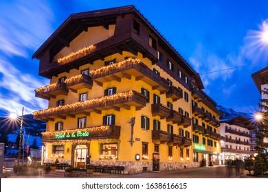 Cortina d'Ampezzo, Italy - February 3 2020: Hotel de la Poste in Cortina d'Ampezzo, Italy on a Winter Evening, a famous Hotel and Restaurant on the Corso Italia Main Street