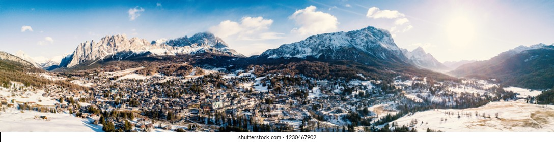 Cortina D'Ampezzo valley panoramic aerial view at day time with snow.