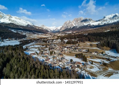 Cortina D'Ampezzo valley panoramic aerial view at day time with snow. Dolomites mountains, Italy.