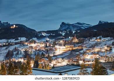 Cortina d'Ampezzo ski resort city at night. Mountains covered in snow on background. Province of Belluno, Italy