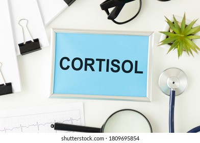 Cortisol glucocorticoid hormone diagnostic concept photo. Figure of adrenal glands with kidneys which produces this steroid hormone, next to stethoscope.