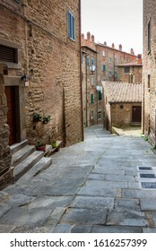 Cortona, Italy - April 11, 2019: View with narrow picturesque medieval street