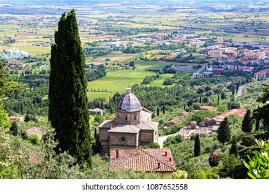 Cortona, Italy. Panoramic view of the tuscany countryside with cypres and the church of Santa Maria delle Grazie al Calcinaio.