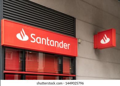 Coruna, Spain; july 01 2019: Santander bank sign on building facade. Banco Santander is one of the biggest banks in Spain