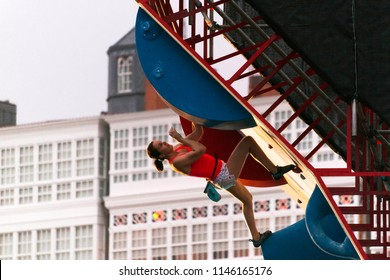 "Coruna, Spain - July 21, 2018: ""Street stunts body extreme"" competition with climbers in psicoblocks event"