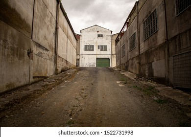 Coruna / Spain - October 04 2019: Abandoned warehouse buildings with broken windows and shutters in Coruna Spain.