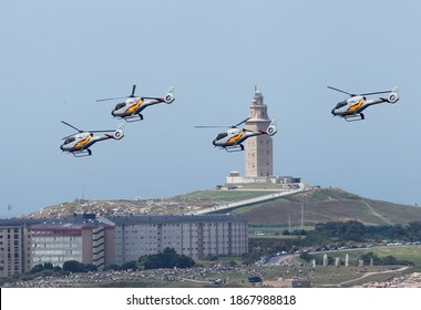 Coruna-Spain. Spanish Air Force Eurocopter EC-120B Colibri helicopter from the Patrulla Aspa display team performing an aerial display at an airshow on July 20,2014