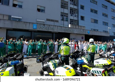 A Coruna-Spain.Healthcare workers dealing with the new coronavirus crisis applaud in return as they are cheered on by Civil Guard and other security forces outside the Hospital on March 26,2020