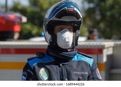 A Coruna-Spain.Portrait of A Coruña local police wearing a motorcycle helmet and mask due to the crisis of the covid-coronavirus pandemic-19 to 14 March 2020