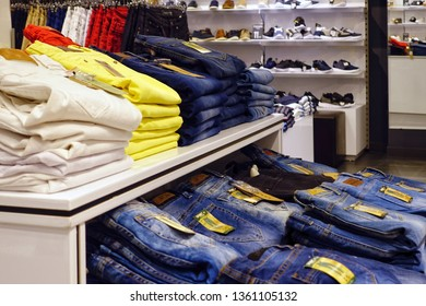 A CORUNIA, SPAIN - APRIL 03, 2018: piles of jeans in a popular youth clothing store