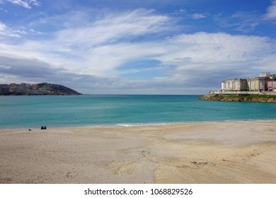 CORUNNA, SPAIN - APRIL 02, 2018: Unknown people walking on the Riazor beach. Corunna is famous touristic city andmunicipalityofGalicia,Spain.