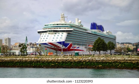 "CORUNNA, SPAIN - APRIL 02, 2018: Beautiful view of the cruise ship ""MV Britannia"" in the Port of Corunna. Corunna is famous touristic city and municipality of Galicia, Spain."
