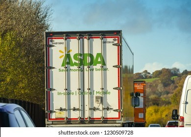 CORYTON, CARDIFF, WALES - NOVEMBER 2018: Articulated lorry driving on the M4 motorway delivering goods to the Asda supermarket on the outskirts of Cardiff.
