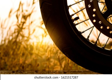 Cose-up silhouette of motorbike on sunset background,Enjoying freedom and active lifestyle.