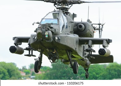 COSFORD, SHROPSHIRE, ENGLAND - JUNE 17: Boeing AH-64 Apache attack helicopter taking off for display on June 17, 2012 in Cosford, Shropshire, England.