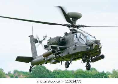 COSFORD, SHROPSHIRE, ENGLAND - JUNE 17: Boeing AH-64 Apache attack helicopter taking off for display at RAF Cosford Airshow on June 17, 2012 in Cosford, Shropshire, England.