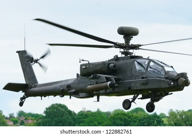 COSFORD, SHROPSHIRE, ENGLAND - JUNE 17: Boeing AH-64 Apache attack helicopter taking off at RAF Cosford on June 17, 2012 in Cosford, Shropshire, England.