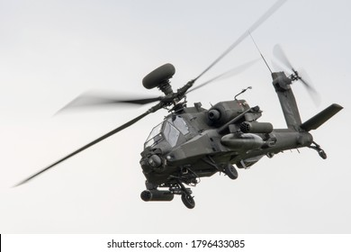 Cosford, Shropshire / England - June 2019: Apache Helicopter Display team demonstrating the firepower and maneuverability of the attack helicopter