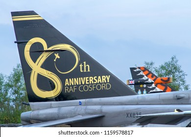 COSFORD, SHROPSHIRE, UK – JUNE 9, 2018: SEPECAT Jaguar T.2A (P) XX835 with commemorative tail, formerly of 6 Sqn (EX) at RAF Coltishall, , on display in the revetment at RAF Cosford .