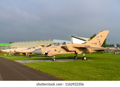 COSFORD, SHROPSHIRE, UK – JUNE 9, 2018: A lineup of Gulf War bombers of the RAF, on display at RAF Cosford, with  Blackburn Buccaneer S.2B XX889, SEPECAT Jaguar GR3A XX725, Panavia Tornado GR.4 ZD793.