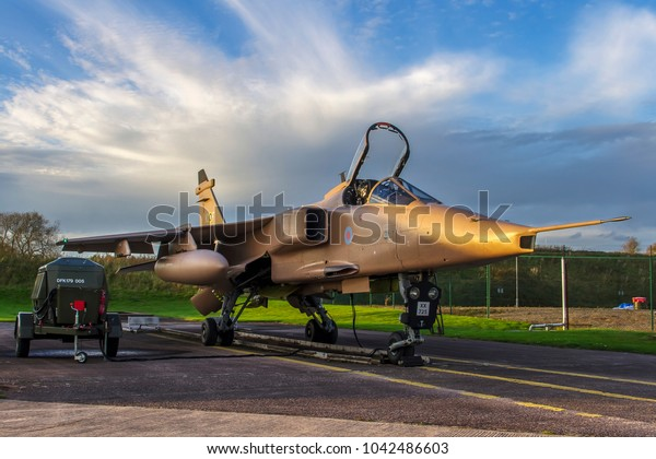 COSFORD, SHROPSHIRE, UK – OCTOBER 25, 2017: SEPECAT Jaguar GR.3A XX725, in Operation GRANBY desert pink paint scheme along with 238 Squadron WWII tail code 'KC-F', on display at RAF Cosford.