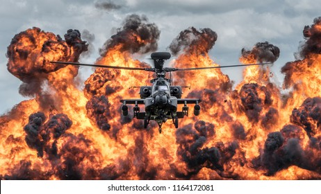 COSFORD, UK - JUNE 11, 2017: a British Army Apache attack helicopter of the Army Air Corps giving an explosive demonstration during Cosford Air Show.