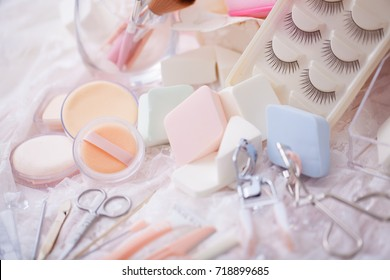 Cosmetic accessories mixed with hair salon equipment in cute candy color.