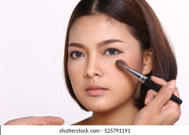 Cosmetic, Applying Make up, Beauty Process, white studio background, Perfect Healthy Skin, Powder brush and palette on cheek, copy space for text and logo