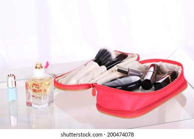 Cosmetic bag on table on light background