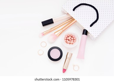 Cosmetic beauty product for woman in gift bag on light background