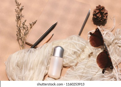 Cosmetic blank plastic tube mockup with eyeglasses and notebook with scarf, lifestyle and healthcare concept, retro style tone