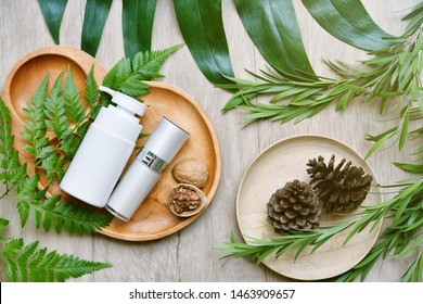 Cosmetic bottle containers with green herbal leaves, Blank label package for branding mock-up, Natural organic beauty product concept, Research and development of purified botany skincare.