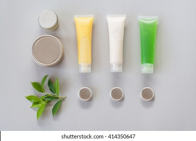 cosmetic box and cosmetic cream isolated on gray background