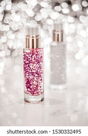 Cosmetic branding, blank label and glamour present concept - Holiday make-up base gel, serum emulsion, lotion bottle and silver glitter, luxury skin and body care cosmetics for beauty brand ads