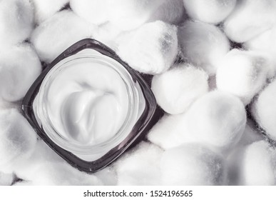 Cosmetic branding, moisturizing emulsion and facial care concept - Luxury face cream for sensitive skin and white cotton balls on background, spa cosmetics and natural skincare beauty brand product