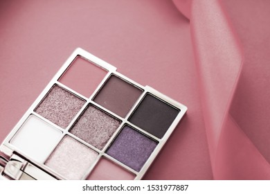 Cosmetic branding, mua and girly concept - Eyeshadow palette and make-up brush on rouge background, eye shadows cosmetics product for luxury beauty brand promotion and holiday fashion blog design