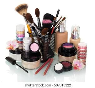Cosmetic brush, eyeshadow, jars with cream, liquid foundation and blusher isolated on white background.