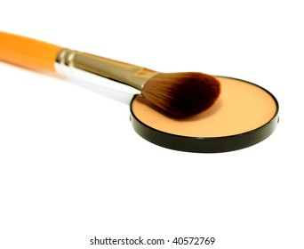 cosmetic brush and face powder isolated on white