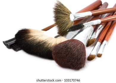 cosmetic brushes on white background