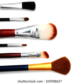 Cosmetic brushes. On a white background.