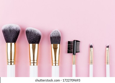 Cosmetic Brushes Set on Pink Background. Various Makeup Brushes for Take Care Skin. Professional Makeup Concealer Powder Blush Eyeshadow Brow Brushes.