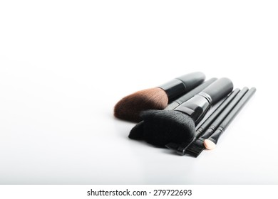 Cosmetic bush set for makeup your face on white background.