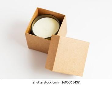 a cosmetic or candle inside a cardboard box package, on white background. Environmentally friendly gift. Zero waste